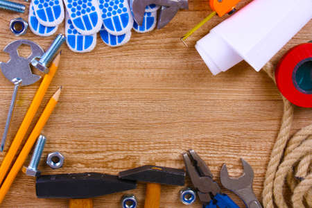 Construction tools on wooden background photo