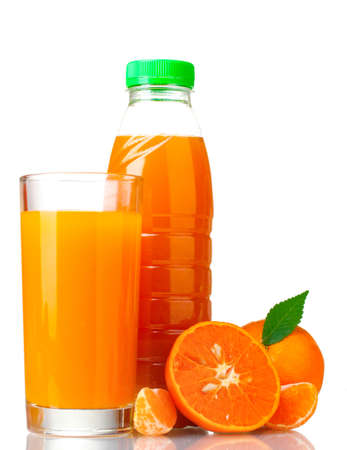 Tangerines, juice glass and bottle isolated on white photo