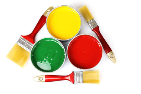 open tin cans with paint and brushes isolated on white photo
