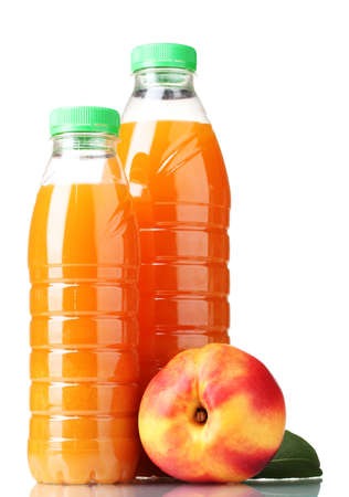 Peach juice in bottles and nectarine isolated on white photo