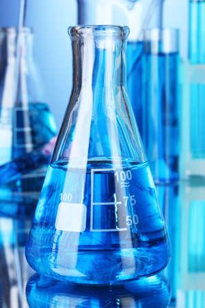 Test-tubes on blue background Stock Photo - 10589314