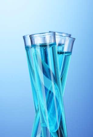 reagents: Test-tubes on blue background Stock Photo