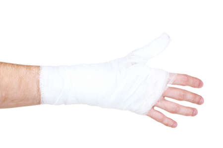 Bandaged hand isolated on white photo