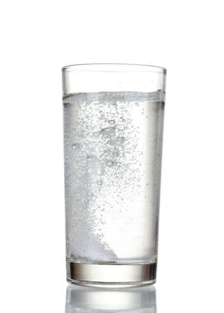Glass with efervescent tablet in water isolated on white photo