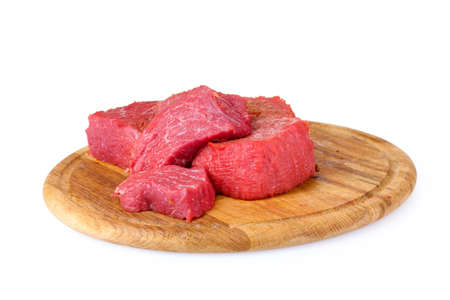 raw meat on wooden board isolated on white photo