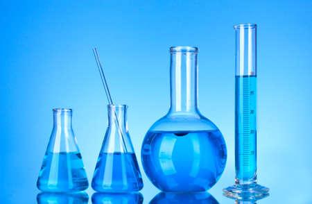 Test-tubes on blue background Stock Photo - 10589476