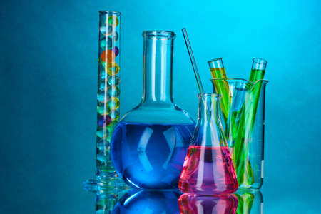 Test-tubes on blue background Stock Photo - 10589474