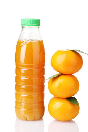juice bottle: Tangerines and juice bottle isolated on white