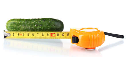 Cucumber with measuring tape isolated on white photo
