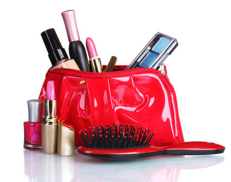 leather bag: Beautiful red makeup bag and cosmetics isolated on white