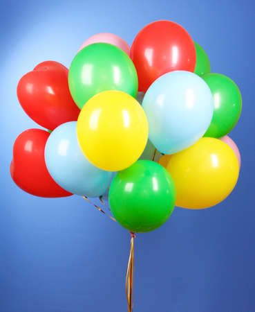 Flying balloons on a blue background photo