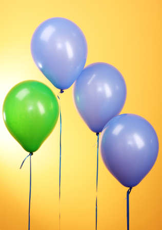 Flying balloons on yellow background Stock Photo - 10645250