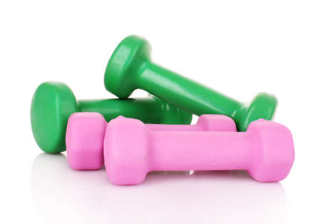 Pink and Green Dumbbells on the white background photo
