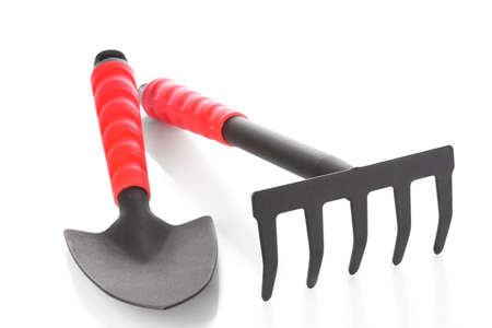 Gardening trowel  and rake on a white background Stock Photo
