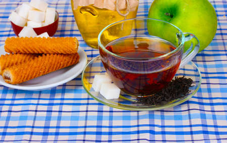 delicious breakfast of boiled eggs, tea, apple and honney Stock Photo - 10670355