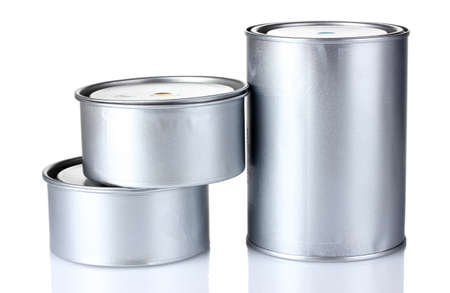closed tin cans with paint isolated on white photo