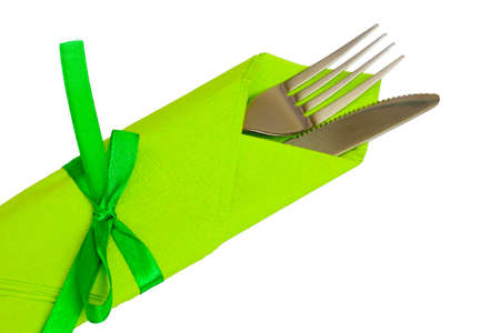 knife and fork on a napkin isolated on white photo