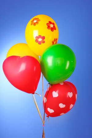 Flying balloons with polka dot on a blue background Stock Photo - 10670423