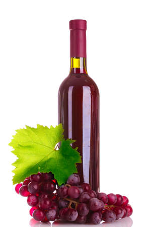 bottle of red wine and grapes isolated on white photo