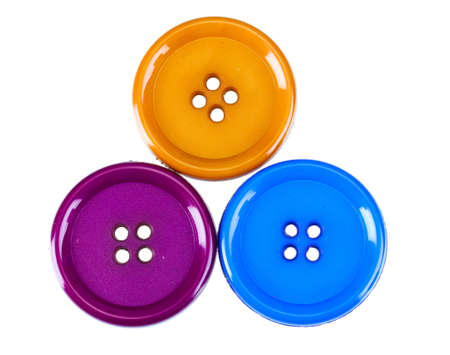 blue button: Three sewing buttons isolated on white Stock Photo