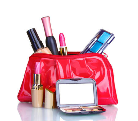 Beautiful red makeup bag and cosmetics isolated on white photo