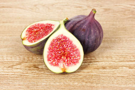 purple fig: Ripe figs on wooden background