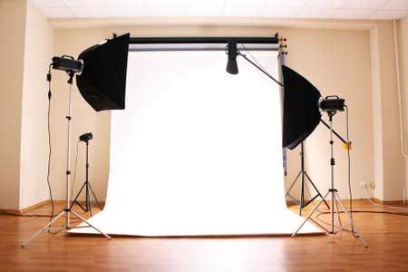 studio photo: Empty photo studio with  lighting equipment