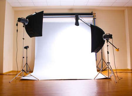 studio photography shot: Empty photo studio with  lighting equipment