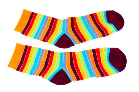 photo of object s: Bright striped socks isolated on white Stock Photo
