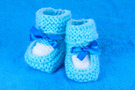 6e973dbb9d90 Blue baby booties on blue background Stock Photo - 10758946