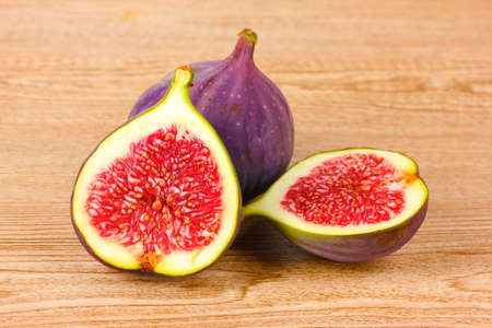 Ripe figs on wooden background Stock Photo - 10758681