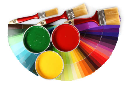 open tin cans with paint, brushes and palette isolated on white photo