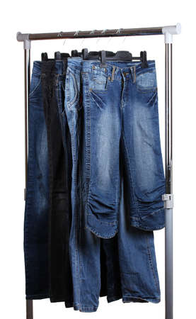 jeans on hangers isolated on white photo