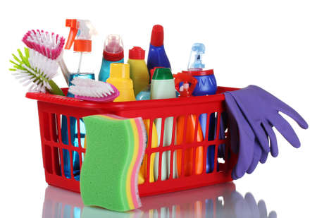 full box of cleaning supplies and sponges isolated on white photo