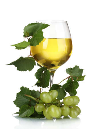 glass of white wine: Ripe grapes, wine glass and bottle of wine isolated on white