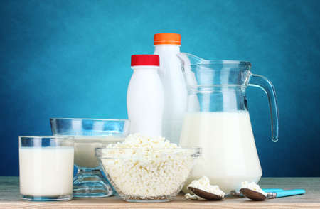 dairy products: Dairy products on wooden table on blue background