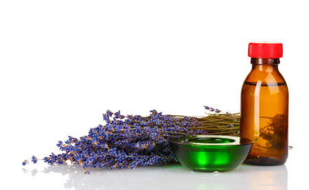 lavender and oil in bottle isolated on white photo