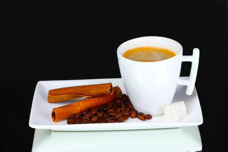 mocca: cup of coffee, coffee beans and cinnamon on gray background