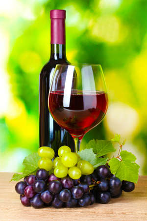 Ripe grapes and  glass of wine on  green background Stock Photo - 10823167