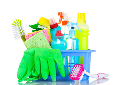 bright housekeeping: full box of cleaning supplies and gloves isolated on white Stock Photo