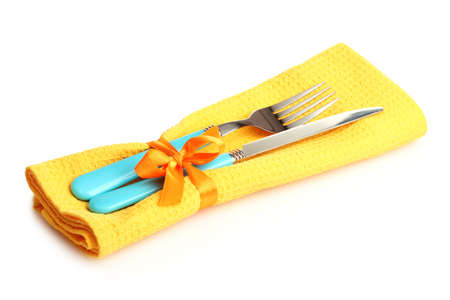 cutlery and napkin isolated on white photo