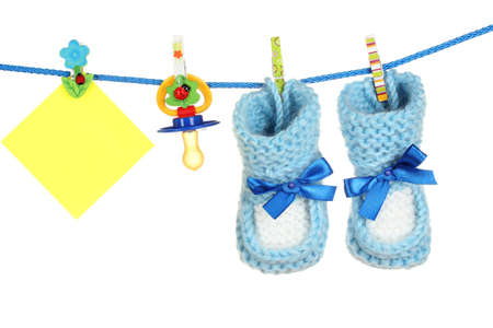 baby socks and booties on a rope isolated on white photo