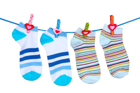 Bright striped socks on line  isolated on white photo