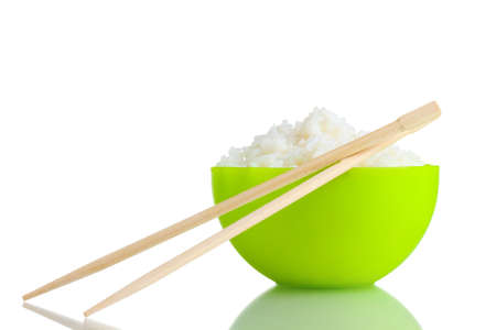 Green bowl of cooked rice and chopsticks isolated on white