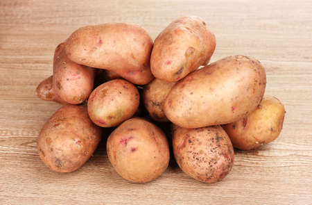 eyespot: Potatoes on wooden background Stock Photo