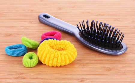 scrunchie: Hair Brush and hair scrunchies on brown background Stock Photo