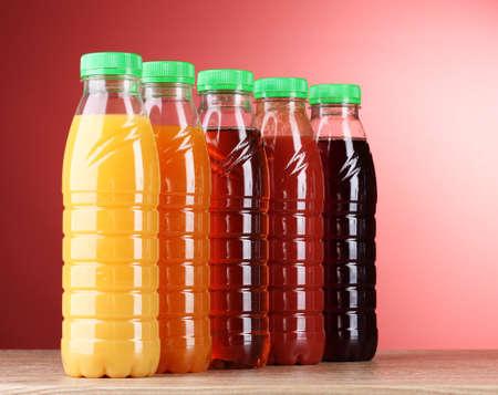 juice bottle: Bottles with juice on red background