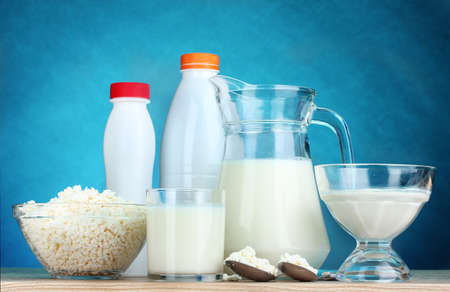 diet product: Dairy products on wooden table on blue background