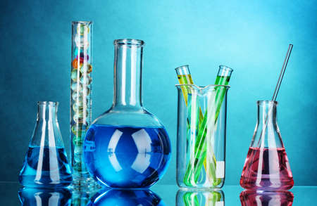 chemical industry: Test-tubes on blue background Stock Photo