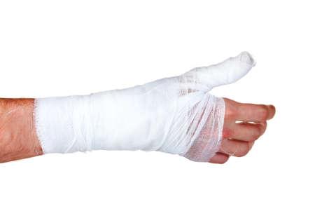 bandaged: Bandaged hand isolated on white Stock Photo